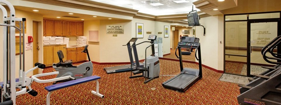 Fitness center with contemporary equipment and towels