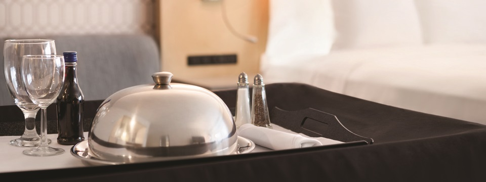 Glassware, drink and meal delivered for room service