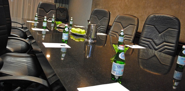 Boardroom with long table, chairs and water