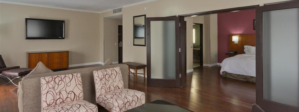 Suite with separate living area and private bedroom