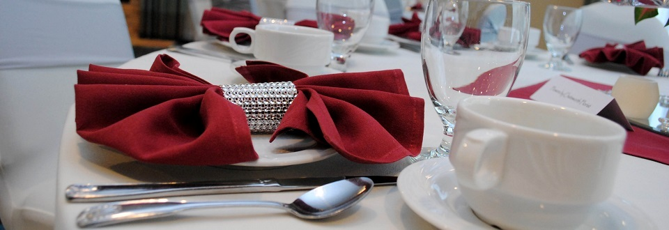 Place settings with red napkins and glassware