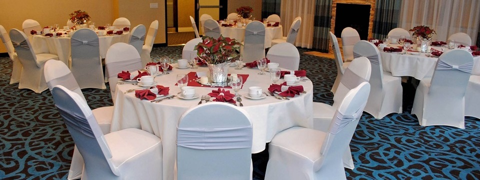 Banquet tables decorated in red and white