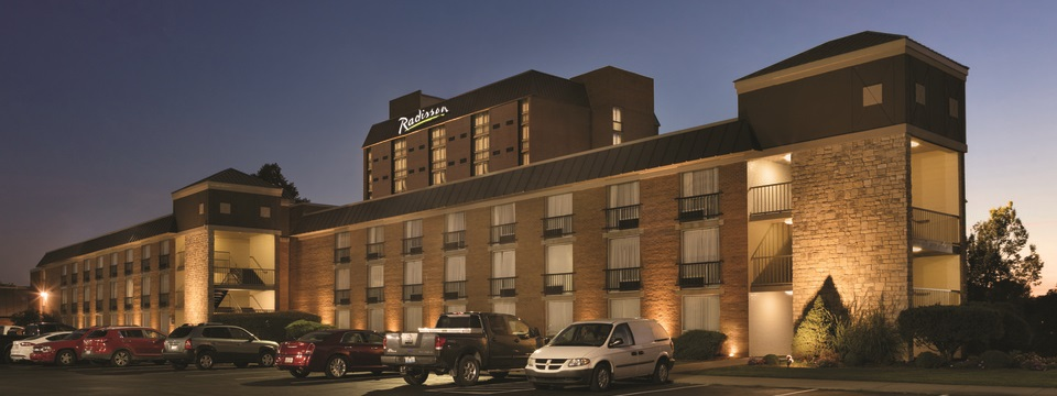 Radisson Hotel Louisville North exterior in the evening