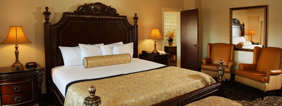 Suite with King Bed, Two Comfortable Chairs and Bench