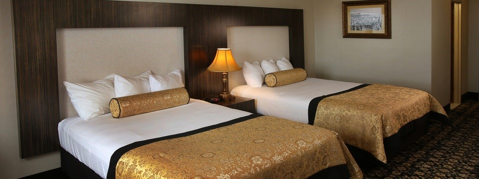 Hotel Room in Atlantic City with Two Beds Featuring Gold Duvets