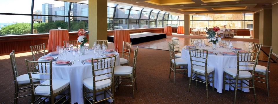 Banquet tables in event venue with views of Atlantic City