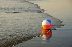 The beach with beach ball in the surf