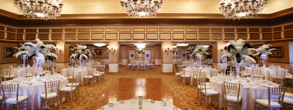 Grand ballroom with crystal chandeliers and reception-style seating