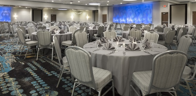 Iowa City ballroom featuring silver-colored table linens