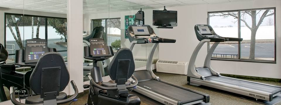 Coralville hotel's contemporary fitness center with treadmills and more