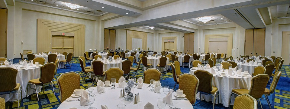 Ballroom with round decorated banquet tables