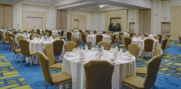 Large ballroom with tables and chairs