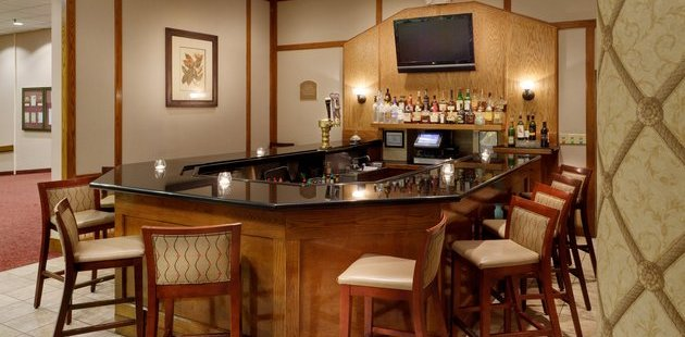 Bar with TV and stools