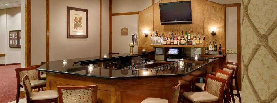 U-shaped bar with flat-screen TV and stools