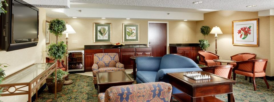 Lounge with comfortable seating and large TV