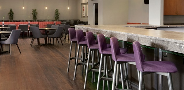 Dining area with bar, high chairs and additional seating
