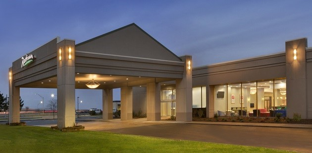 Hotel exterior with carport lit up at night