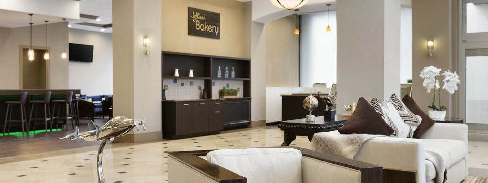 Modern lobby with white, brown and black accents