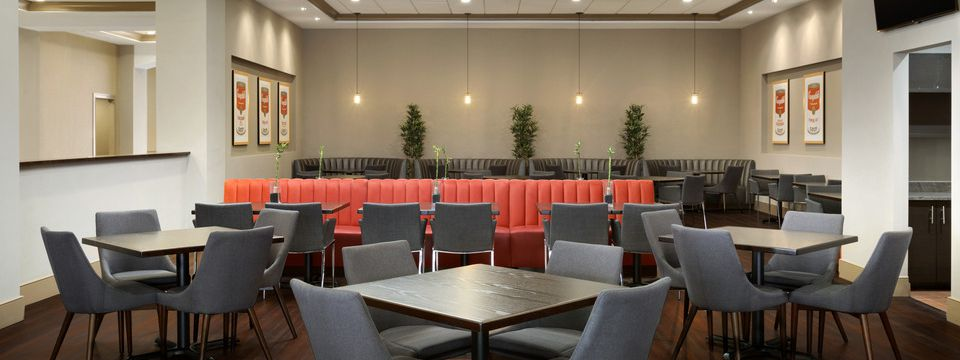 Restaurant seating including orange banquettes