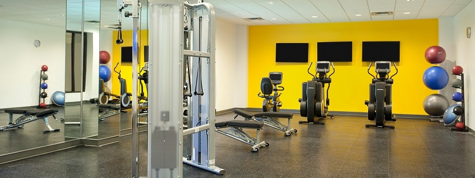 Fitness center with weight machine and cardio equipment