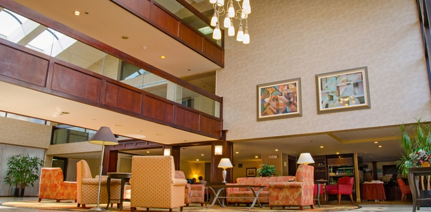 Hotel lobby with high ceiling and seating area