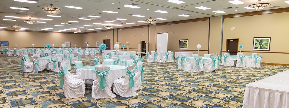 Fort Worth ballroom set up for a banquet with teal and white decor