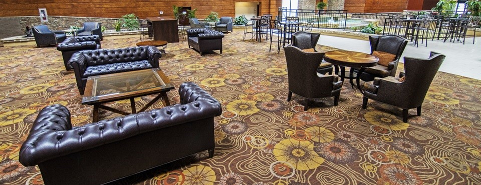 Hotel's comfortable lobby with leather sofas, armchairs and tables