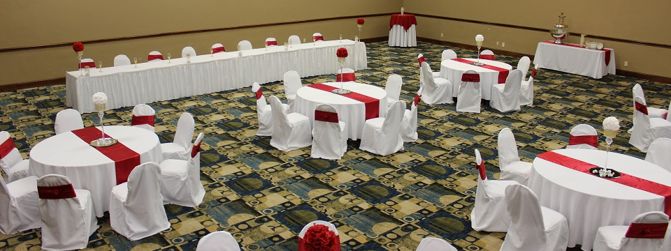 Fort Worth banquet space set up with round tables and a head table