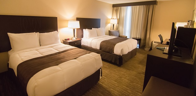 Hotel room with two beds and flat-screen TV