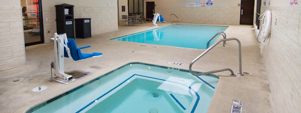 Hotel's indoor pool, hot tub and accessible pool lifts