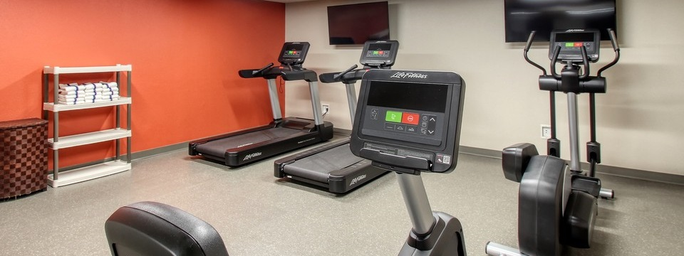Fitness center with stationary bike and treadmills