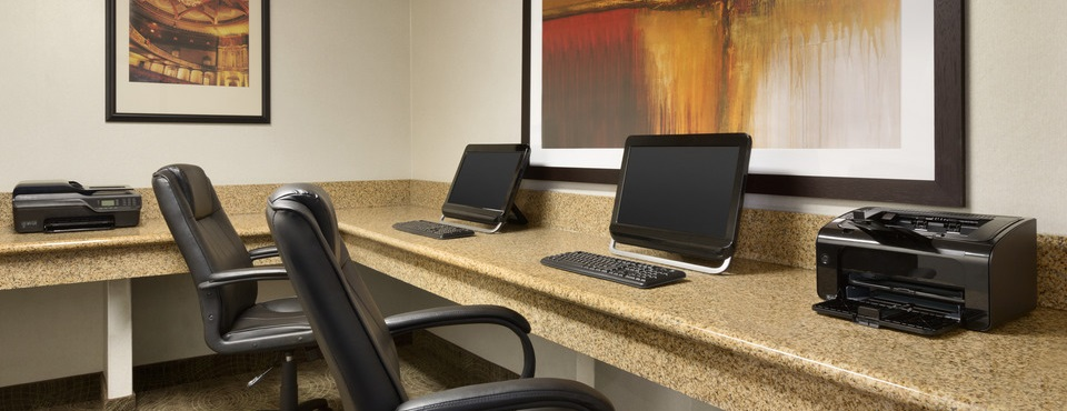 Business center with computers and printers