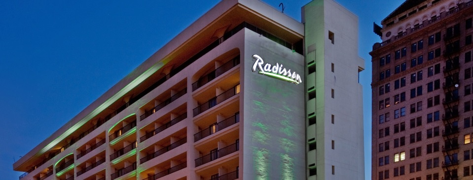 Exterior of the Radisson hotel lit up at night