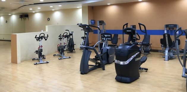 Fitness center with cardio equipment and weight machines
