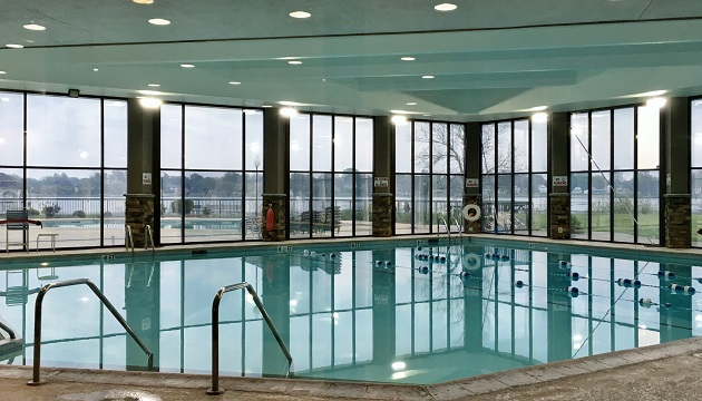 Sparkling indoor pool and floor-to-ceiling windows