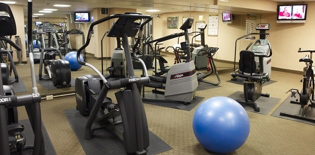 Hotel fitness center with elliptical, exercise ball and bike