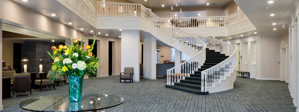 Elegant staircase in center of lobby