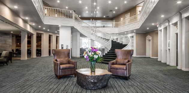 Lobby with chairs and elegant staircase