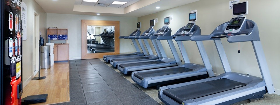 Row of treadmills in the on-site fitness center