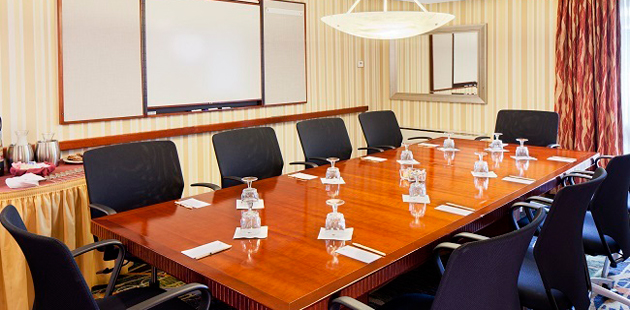 Professional conference room with long table and leather chairs