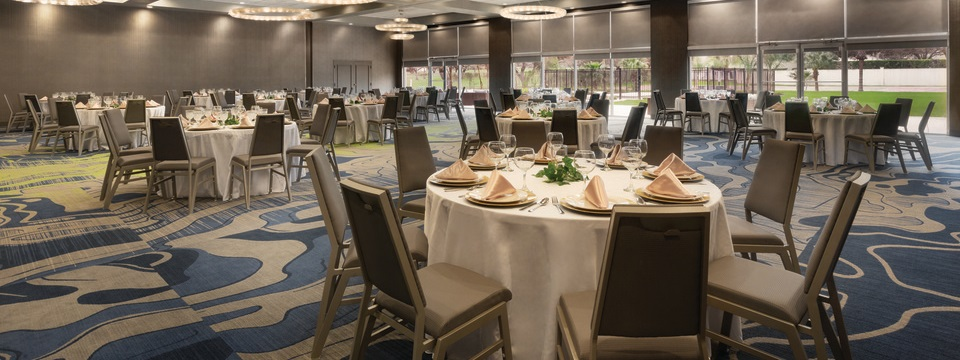 Event space with chairs and round tables arranged for a banquet