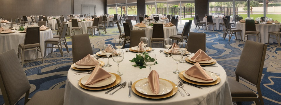 Place settings with glasses, silverware and folded napkins
