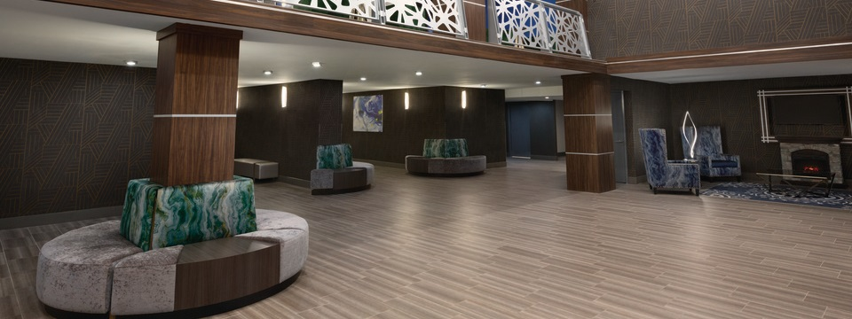 Welcoming lobby featuring wood flooring, contemporary décor and a sitting area with a fireplace