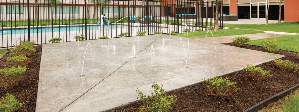 Splash pad beside the outdoor pool