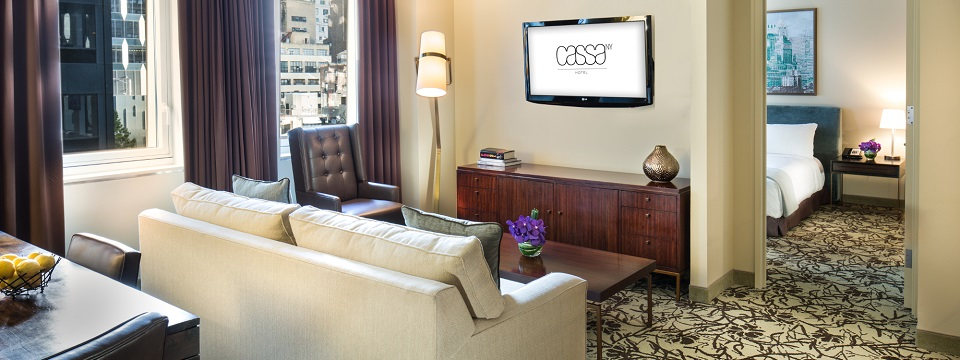 The Cassa Suite with private bedroom, flower vase and separate living room with TV