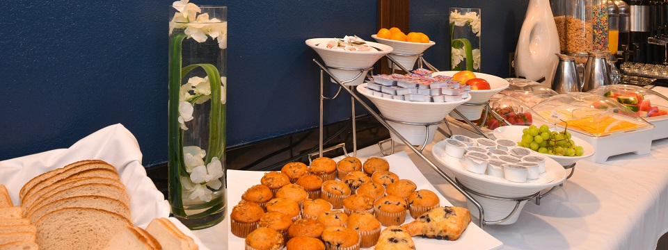 Hotel's breakfast spread with muffins, scones, fruit and cereal