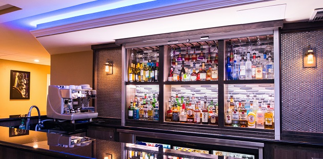 Well-stocked bar at 4Corners Bistro with blue lighting