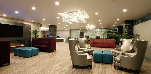 Welcoming lobby with flat-screen TV and fireplace