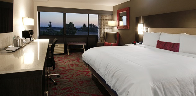 Hotel room with a plush bed, a flat-screen TV and a gorgeous view