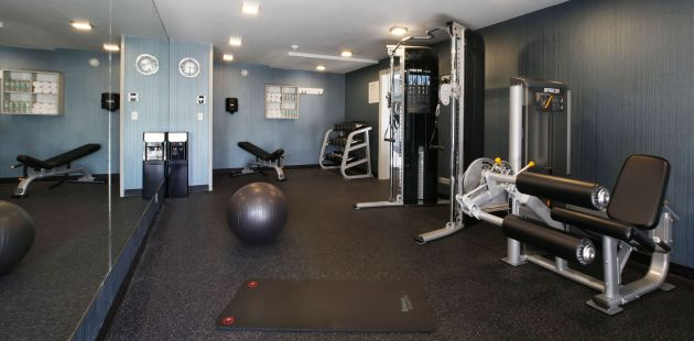 Fitness center with weight training equipment and pilates ball